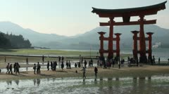 Japan tourism, floating torii gate, people visit, beach, tourists Stock Footage