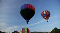 Balloons lift off into sky Stock Footage