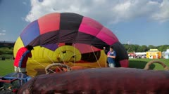 Fan blows up hot air balloon - stock footage