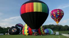 Balloons take off from ground - stock footage
