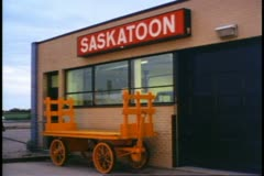 Saskatoon, Saskatchewan, Canada, sign on train station wall Stock Footage