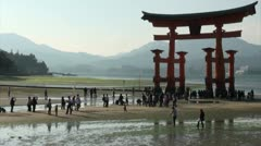 Japan tourism, time lapse of people visiting the beach and famous torii gates Stock Footage