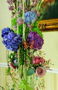 Bouquet of flowers in interior. Stock Photos