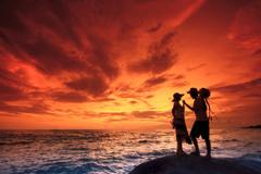 couples on the beach - stock photo
