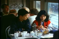"""""""The Canadian"""" train Dining Car, Asian couple at table Stock Footage"""