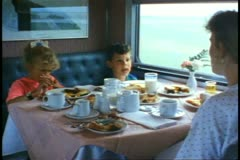"""""""The Canadian"""" train Dining Car, table, two children, boy and girl Stock Footage"""