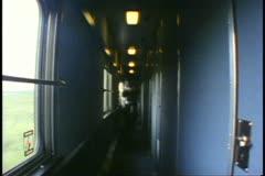 """The Canadian"" train, coach car hallway, sleeping car attendant walks Stock Footage"
