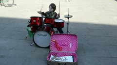 Young kid child play drums street music day. people audience Stock Footage