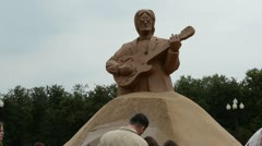 John lennon legend beatles leader sculpture sand people vilnius Stock Footage