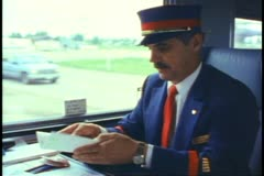 "The conductor seated with paperwork on ""The Canadian"" train Stock Footage"