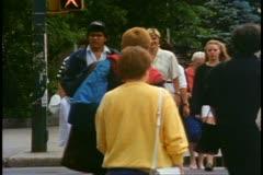 Stock Video Footage of Saskatchewan, Canada, crowd on sidewalk, 1990