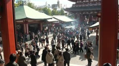 Tourist crowds visit a popular temple complex in Tokyo Stock Footage