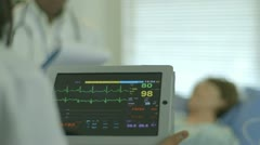 Stock Video Footage of nurse using a portable patient monitor