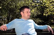 Stock Photo of handsome man in a park