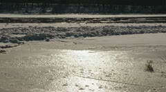 Partly frozen river neris in winter and ice floating in water Stock Footage