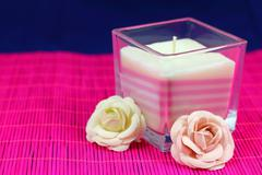 Candle and flowers Stock Photos