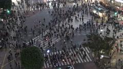 Pedestrian crossing in Shibuya at night Stock Footage