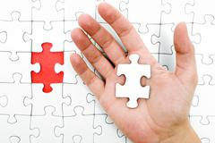 Holding a Jigsaw Piece - stock photo