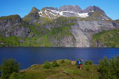 hiker by fjord in norway - stock photo