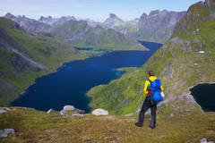 hiking by fjord in norway - stock photo