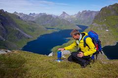 lofoten mountaineering - stock photo