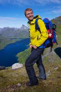 smiling hiker in norway - stock photo