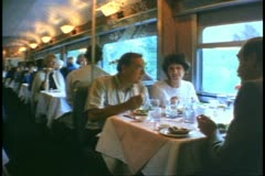 """""""The Canadian"""" train, Dining Car, four people seated and chatting Stock Footage"""