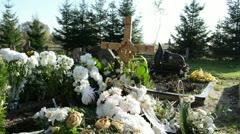 New grave cemetery wooden cross flower memory dead family member Stock Footage