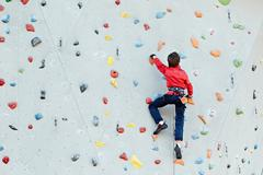 exercise climbing wall - stock photo