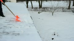 Worker shovel push snow roof. hard winter works Stock Footage