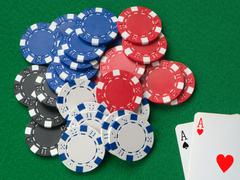 two aces winning lots of poker chips. - stock photo