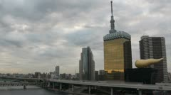 Time lapse of clouds flying over the skyline of Tokyo city in Japan Stock Footage