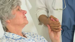 Caucasian patient holding her doctor's hand Stock Footage