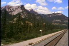 """POV from """"The Canadian"""" train, retreating shot, British Columbia scenery Stock Footage"""