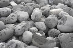 Grey pebbles background Stock Photos