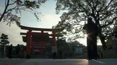 Man takes a picture of the Fushimi Inari temple complex Stock Footage