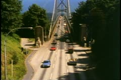 Vancouver, British Columbia, Lion's Gate Bridge, park with traffic, 1990 Stock Footage