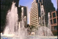 Vancouver, British Columbia, fountains, buildings in background, backlight Stock Footage