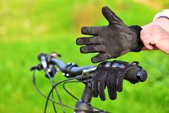 Mountain biker wears old gloves Stock Photos