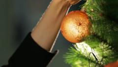 Decoration ball on a green Christmas tree 2 - stock footage