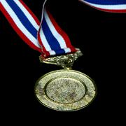 Stock Photo of isolated blank gold medal with tricolor ribbon