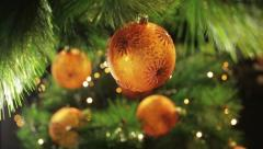 Decoration ball on a green Christmas tree 4 Stock Footage