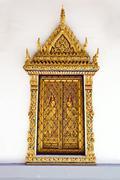 Golden windows at wat phra keao temple in grand palace, bangkok thailand Stock Photos