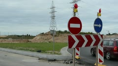 Stock Video Footage of directional road sign start roundabout cars go road construction