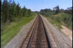 """The Canadian"" train, POV out back of train of retreating railroad tracks Stock Footage"