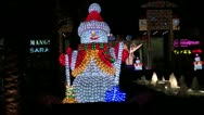 Snowman in front of mall Stock Footage