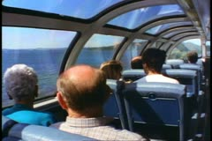 """The Canadian"" train, observation dome car interior, lake and mountains Stock Footage"