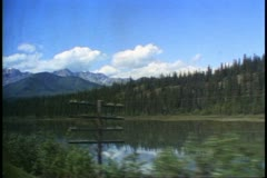 """""""The Canadian"""" train, POV out window of train, lake, mountains, scenery Stock Footage"""