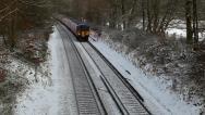 Train on snowy tracks 3 Stock Footage