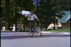 Jasper Park Lodge, Alberta, Canada, bellman on a bicycle, carry tray Stock Footage